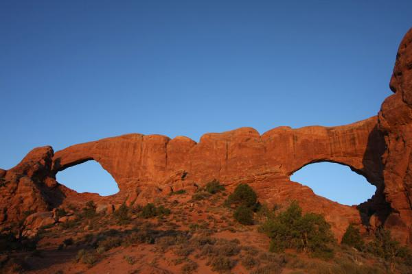 First rays of sunlight falling on North and South Window | Arches National Park | U.S.A.