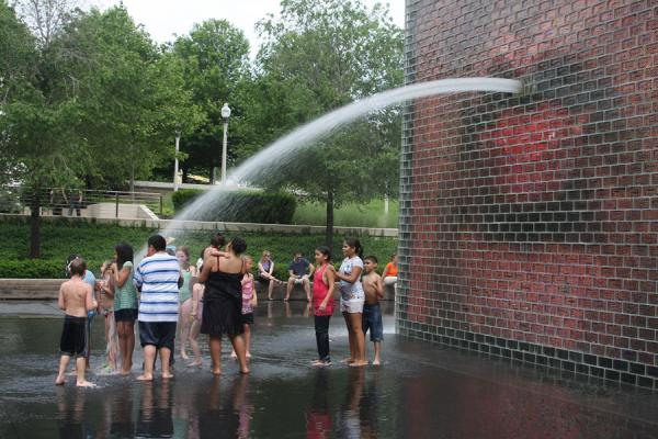 Picture of Chicago Millennium Park (U.S.A.): Having a shower under one of the water towers at Crown Fountain
