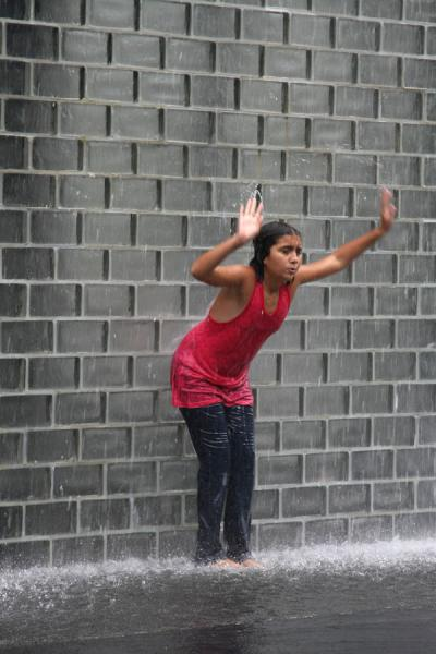 Girl having fun under one of the water towers | Chicago Millennium Park | U.S.A.