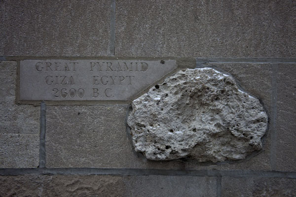 Fragment of the Great Pyramid stuck to the wall of the Chicago Tribune Tower | Chicago Tribune stones | U.S.A.