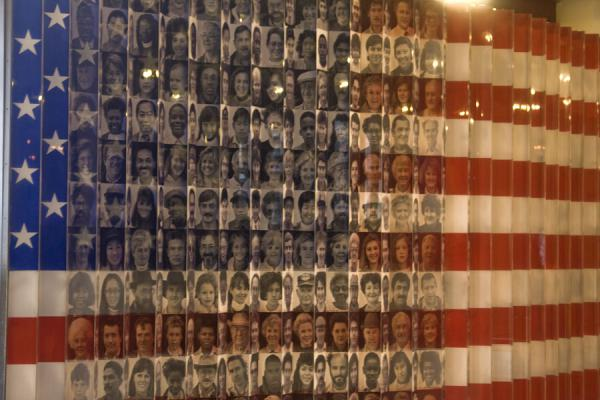 American flag with faces of immigrants | Ellis Island | U.S.A.