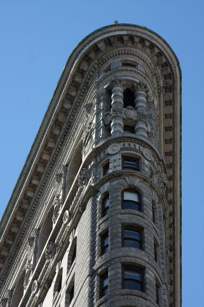 Picture of Flatiron Building (U.S.A.): Close-up of top corner of Flatiron Building