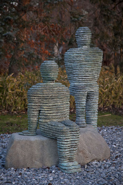 Layered stone sculpture of two humans | Grounds for Sculpture | U.S.A.