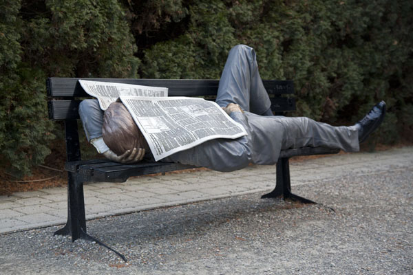 Businessman sleeping under newspaper by Seward Johnson | Grounds for Sculpture | U.S.A.