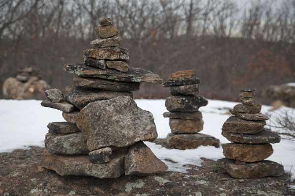 Stony cairns on a snowy rock in the forest at the east side of the highlands | Hudson Highlands | U.S.A.