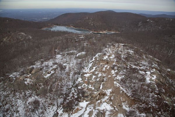 View from the tower at South Beacon mountain, with the snowy hills and the Beacon reservoir in the background | Hudson Highlands | U.S.A.