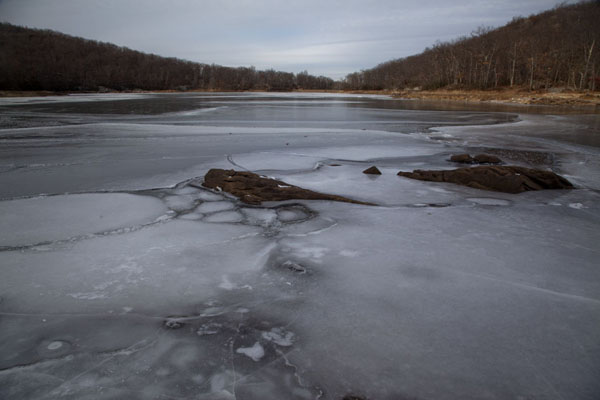 Frozen lake of Beacon Reservoir in the afternoon | Hudson Highlands | U.S.A.