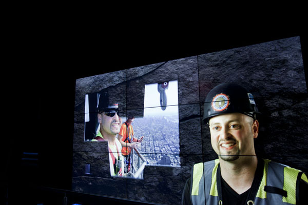 Construction workers explaining their tasks projected on a rock in the basement of the building - 美国