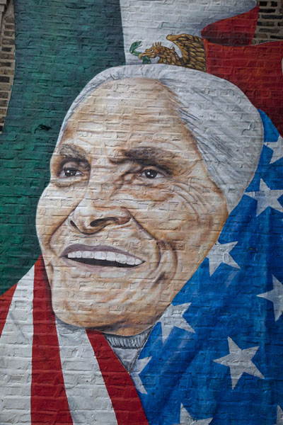 Woman with Mexican traits wrapped in the Stars and Stripes | Pilsen Murals | United States