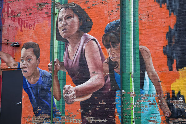 Picture of Pilsen Murals (U.S.A.): Woman with children on a huge mural above a parking lot in Pilsen