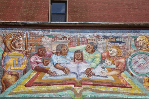 Mural with Mexicans over a big book with two guardians appearing as animals | Pilsen Murals | United States