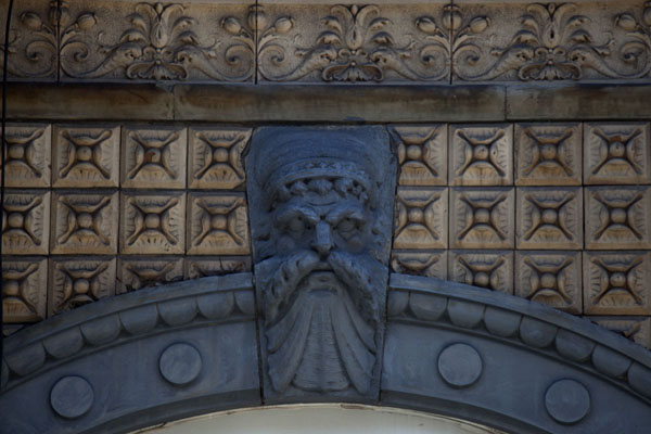 Picture of Sculpted head above a window on the building featured on the Physical Graffiti album of Led Zeppelin
