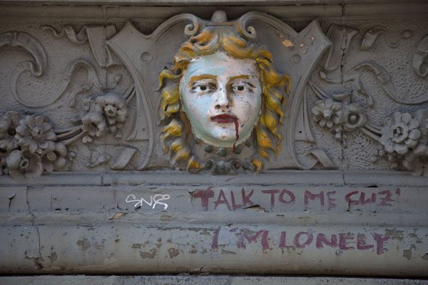 Picture of Sculpted head with paint on the exterior of the building on St Marks Place whereNew York - U.S.A.