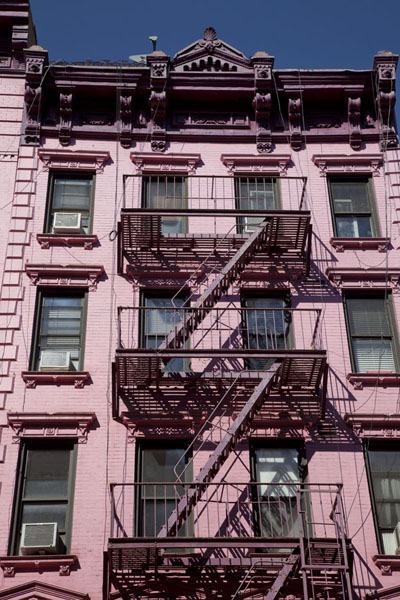 Stairs alongside a pink building in Soho | Soho | U.S.A.