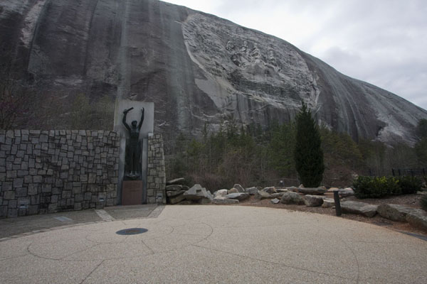 Statue depicting Valor with the bas relief sculpture on Stone Mountain in the background | Stone Mountain | U.S.A.