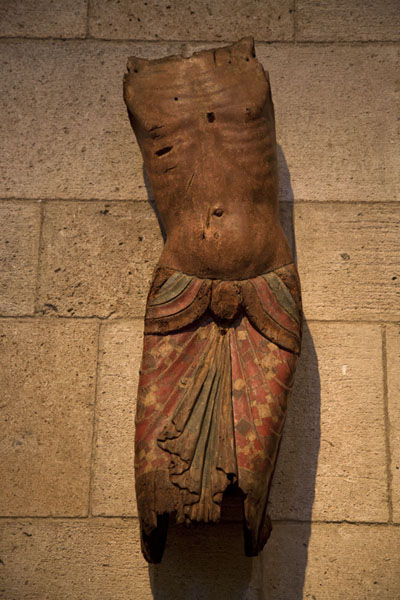 Torso of Christ, a 12th century painted wooden sculpture from France in the Fuentidueña Chapel | The Cloisters | U.S.A.