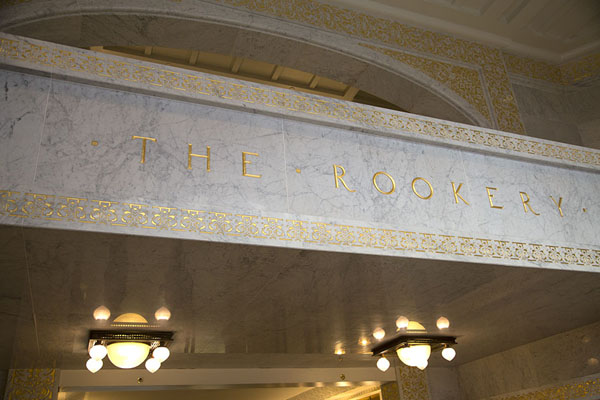 The name of the building in gold over the entrance of the building | The Rookery | U.S.A.