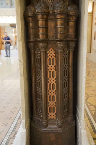 Original wrought iron column exposed from within the white cover | The Rookery | U.S.A.