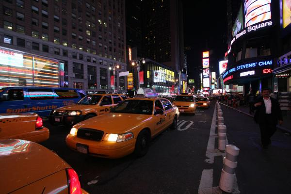 Picture of Times Square (U.S.A.): Yellow cabs at Times Square in the late evening
