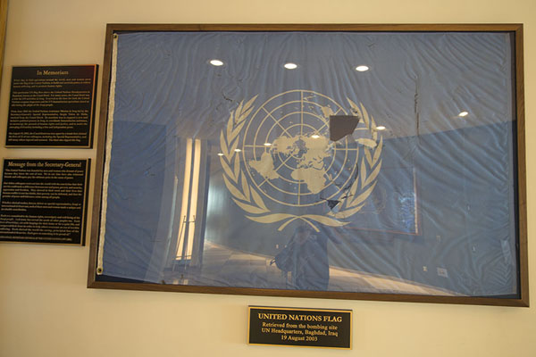 Damaged flag of the United Nations that flew over the UN office that was destroyed by a terrorist attack in 2003 | United Nations Headquarters | U.S.A.