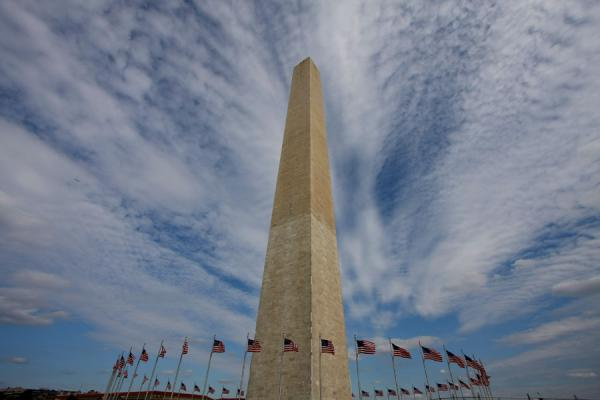 Picture of Obelisk under the clouds: Washington Monument and flags