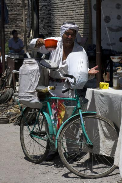 Street vendor selling drinks from his bike at Kontepa bazaar | Kontepa Bazaar | Uzbekistan