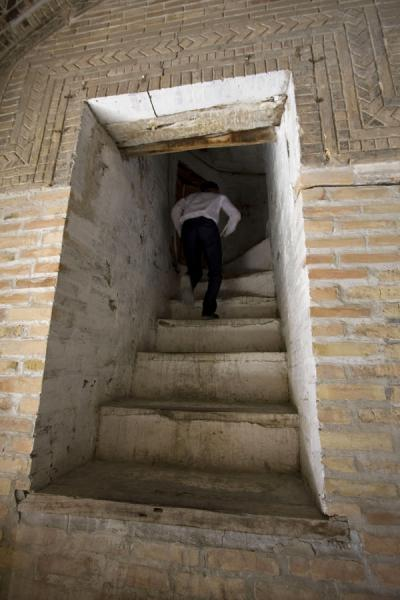 Picture of Student running up the stairs to his roomBukhara - Uzbekistan