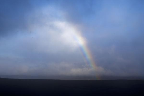 Picture of Bright rainbow over the ash plain, with the cloud of Benbow in the backgroundAmbrym - Vanuatu