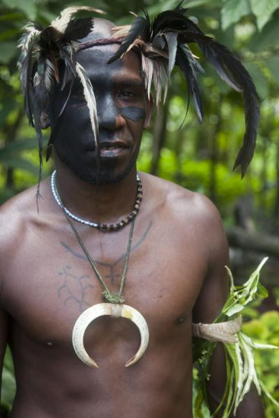 Picture of Nemalits Small Namba's (Vanuatu): Small Namba chief with painted face, wearing a wild boar tusk