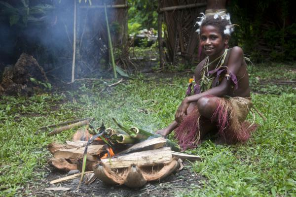 Picture of Small Namba girl demonstrating cooking in bamboo sticksNemalits - Vanuatu