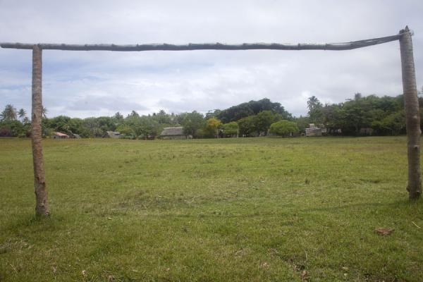 Picture of Port Resolution (Vanuatu): Looking through one of the goals of the central square of Port Resolution, the local football field