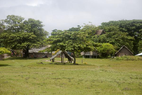 Picture of Port Resolution (Vanuatu): Traditional houses surrounding the football field in Port Resolution