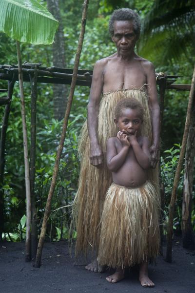 Picture of Tanna traditional village (Vanuatu): Old woman and child from a traditional village on Tanna island