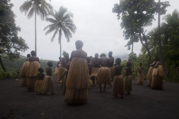 Picture of Tanna traditional village (Vanuatu): Man, women and children dancing in their traditional attire