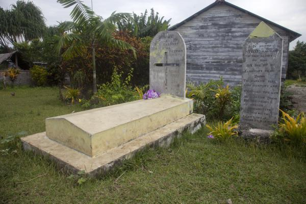 Picture of Wala Island (Vanuatu): Tombstones and church in the village on Wala Island