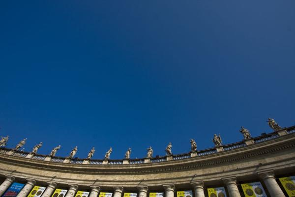 Line of statues of saints on one of the colonnades around Saint Peters square | Saint Peters Basilica | Vatican City