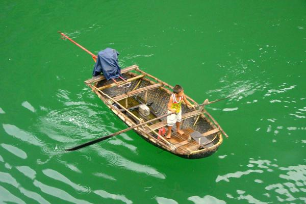 Picture of Halong Bay (Vietnam): Vietnamese boy on boat, Halong Bay
