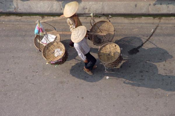 Two persons wearing a conical hat walking the street | Conical hats | Vietnam