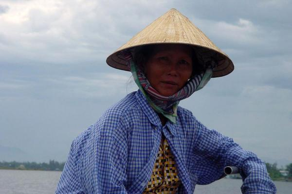 Steering a boat | Conical hats | Vietnam