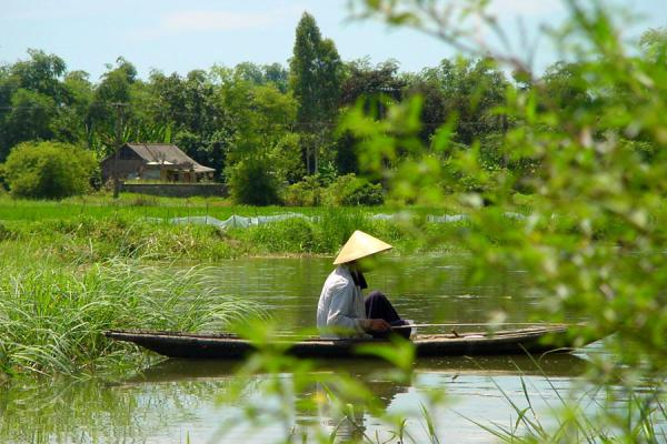 Picture of Conical hats (Vietnam): Woman on boat with conical hat