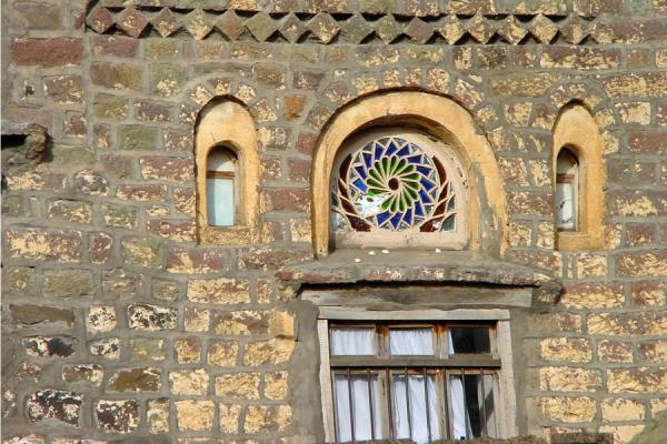 Picture of Jibla (Yemen): Colourful window and stone decorations in Jibla house