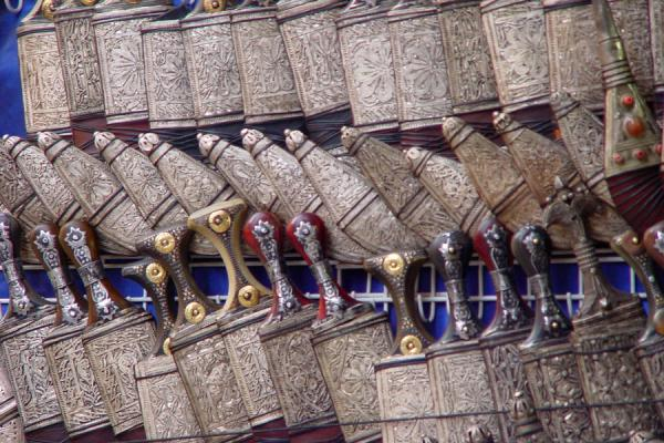 Picture of San'a suq (Yemen): Intricately decorated jambiyas for sale in San'a's suq