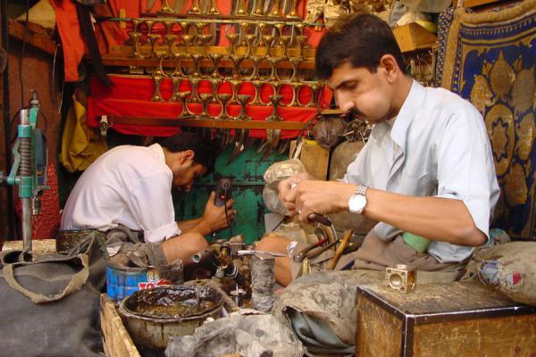 Picture of San'a suq (Yemen): Craftsman working on a jambiya in San'a's suq
