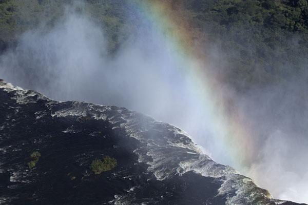 Foto van Rainbow at the edge of the fallsVictoria Falls - Zimbabwe