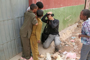 Taking pictures surrounded by Ethiopian kids