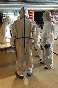 Hotel employees in protective clothing
