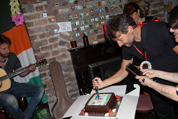 Picture of Ireland193 (Ireland): Cutting a special world map cake at the party